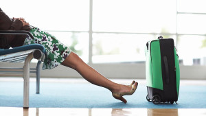 1400-art-frommers-woman-legs-luggage-sitting-airport.imgcache.rev1385067178347.web.672.378
